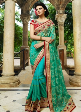 Distinctively Beads And Stone Work Wedding Saree