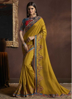 Embroidered Work Silk Georgette Gold and Navy Blue Classic Saree