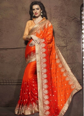 Energetic Coral And Red Color Wedding Saree
