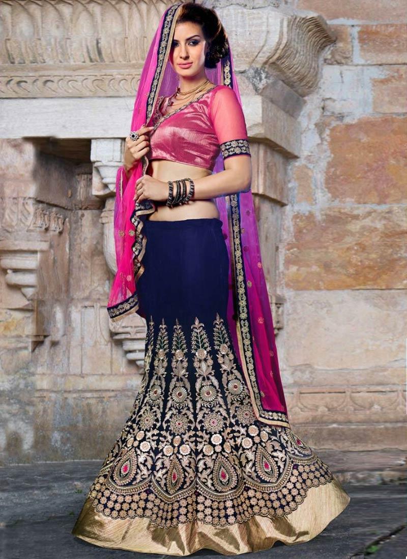 Engrossing Booti Work Velvet Bridal Lehenga Choli