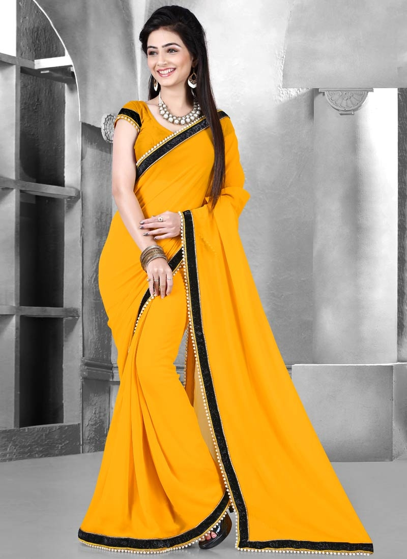 Enthralling Mustard Color Lace Work Casual Saree
