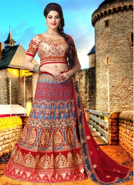 Enticing Patch Border Work Net Bridal Lehenga Choli