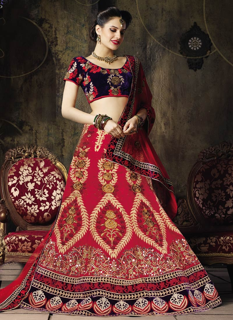 Entrancing Velvet Patch And Mirror Work Wedding Lehenga Choli