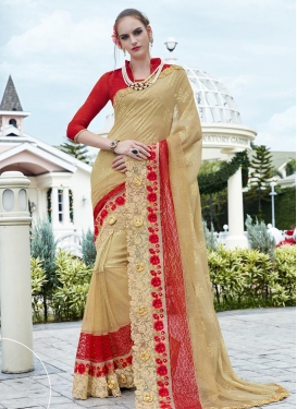 Ethnic Faux Georgette Beige and Red Designer Contemporary Saree For Ceremonial