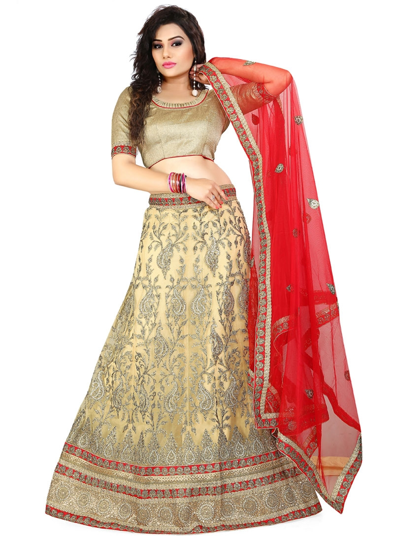 Exceeding Cream Color Stone Work Wedding Lehenga Choli