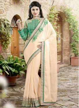 Exciting Cream Color Faux Chiffon Designer Saree