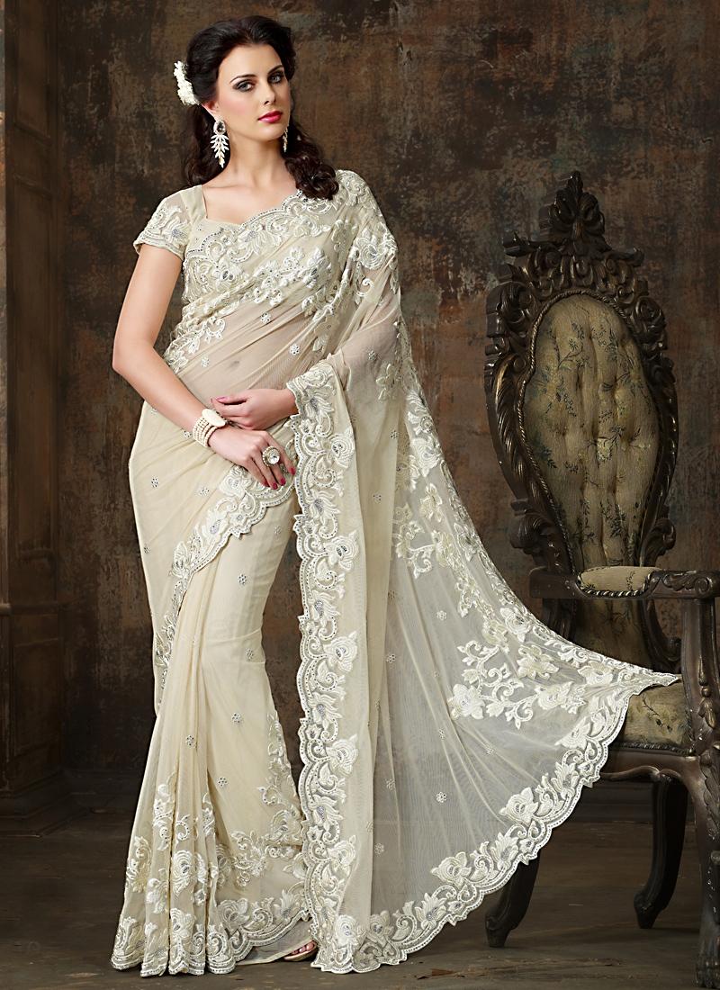 White Saree Tamanna In Veeram: Exotic Off White Net Wedding Saree