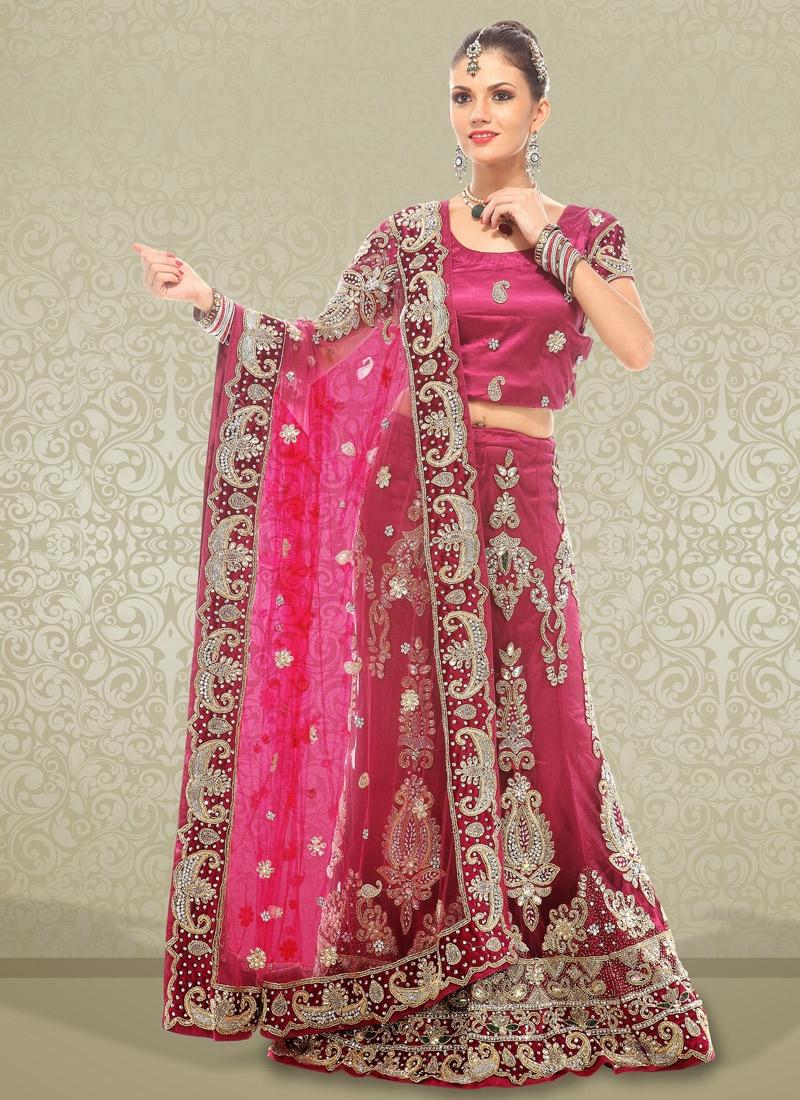 Exotic Wine Net Bridal Lehenga Choli