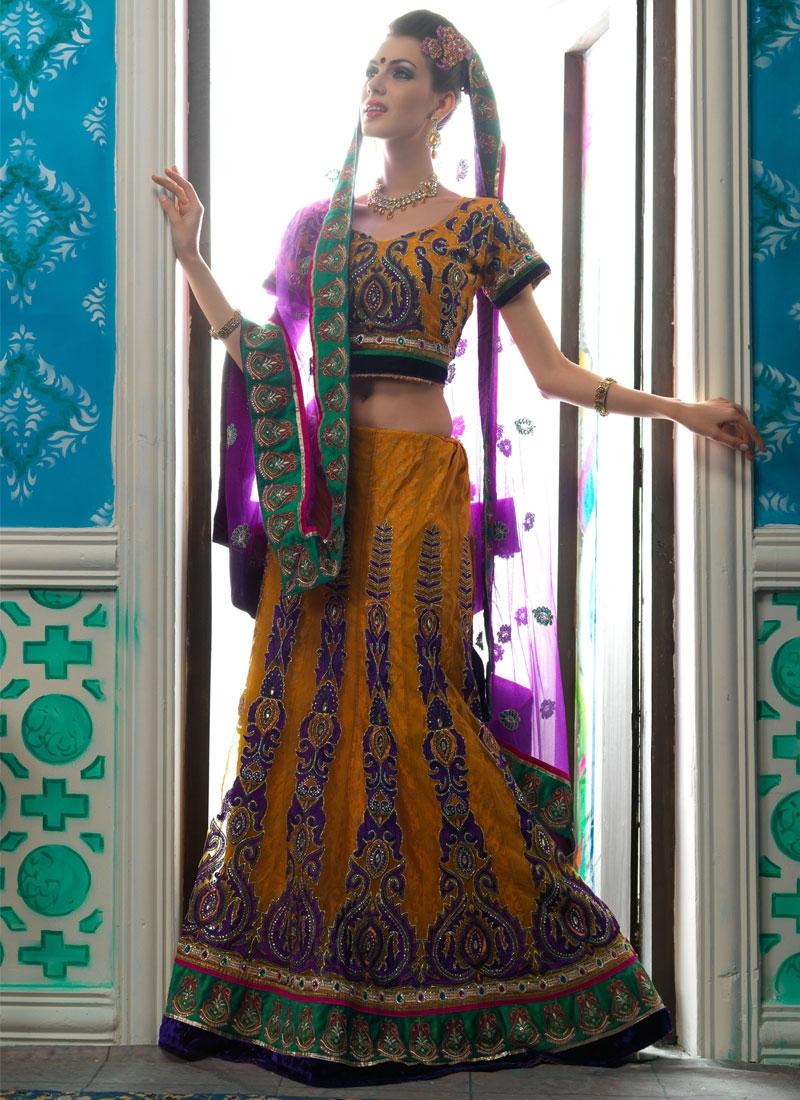 Exquisite Orange Color Net Lehenga Choli
