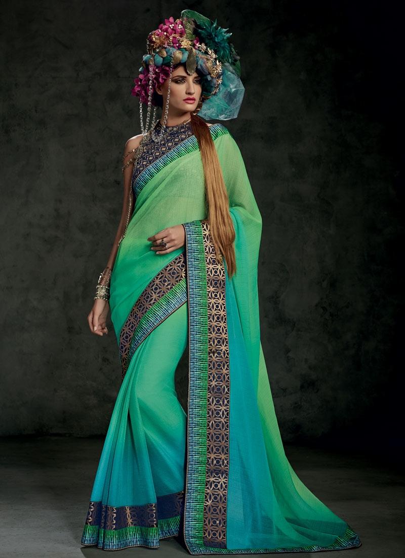 Exuberant Lace Work Mint Green Color Party Wear Saree