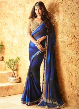 Eye-Catchy Lace Work Contemporary Saree For Festival