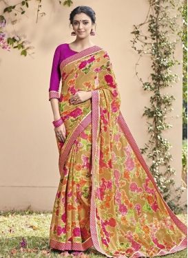 Fabulous Lace Work Brasso Georgette Mustard and Rose Pink Trendy Saree