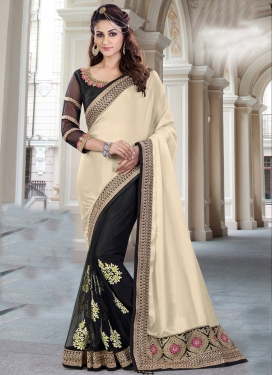 Fashionable  Black and Cream Net Half N Half Saree