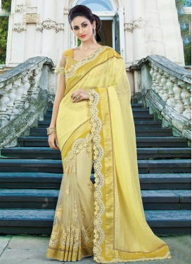 Faux Chiffon Cream and Yellow Beads Work Classic Saree