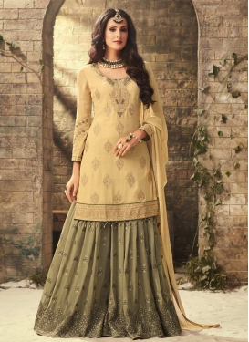 Faux Georgette Cream and Olive Embroidered Work Sharara Salwar Suit