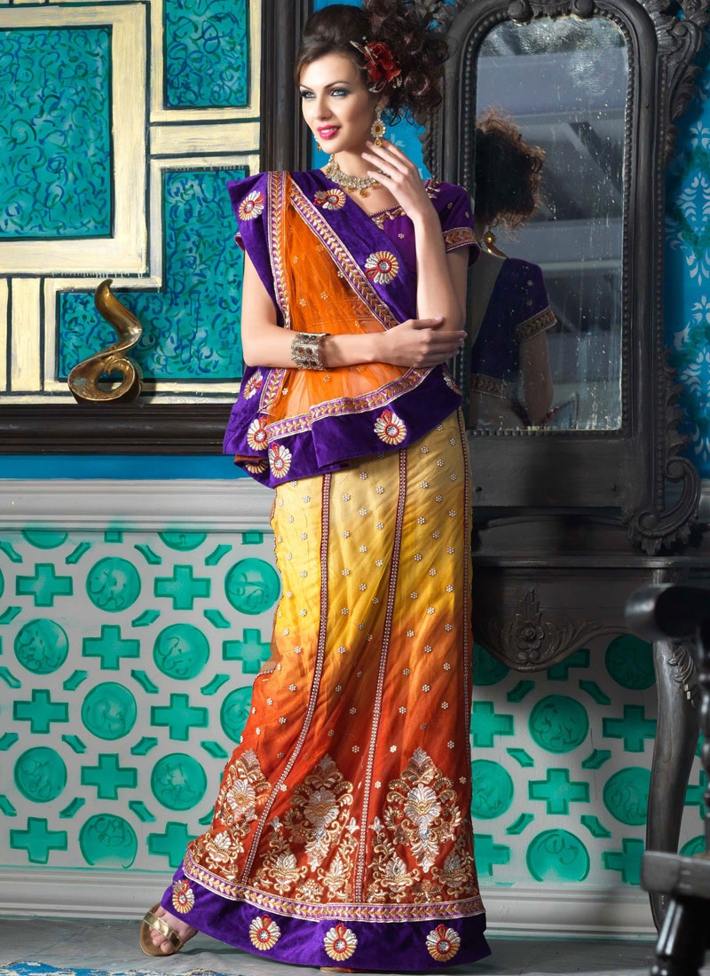 Flamboyant Coral And Gold Color Lehenga Saree