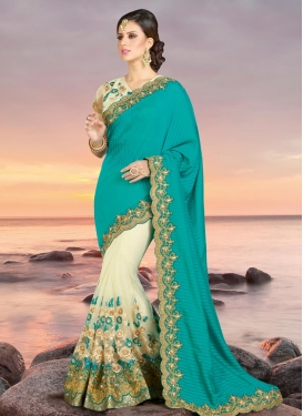 Flattering Aqua Blue and Cream Half N Half Saree