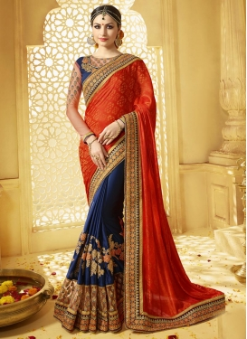 Flattering Jacquard Navy Blue and Orange Half N Half Saree