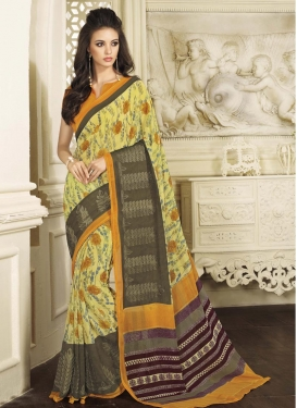 Flawless Brown and Yellow Print Work Classic Saree