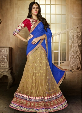 Glamorous Patch Enhanced Net Wedding Lehenga Choli