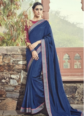 Gleaming Maroon and Navy Blue Trendy Saree For Ceremonial