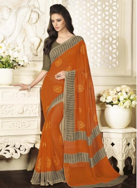 Glorious Brown and Orange Trendy Designer Saree