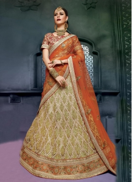 Glorious Net Beige and Coral Trendy Lehenga Choli