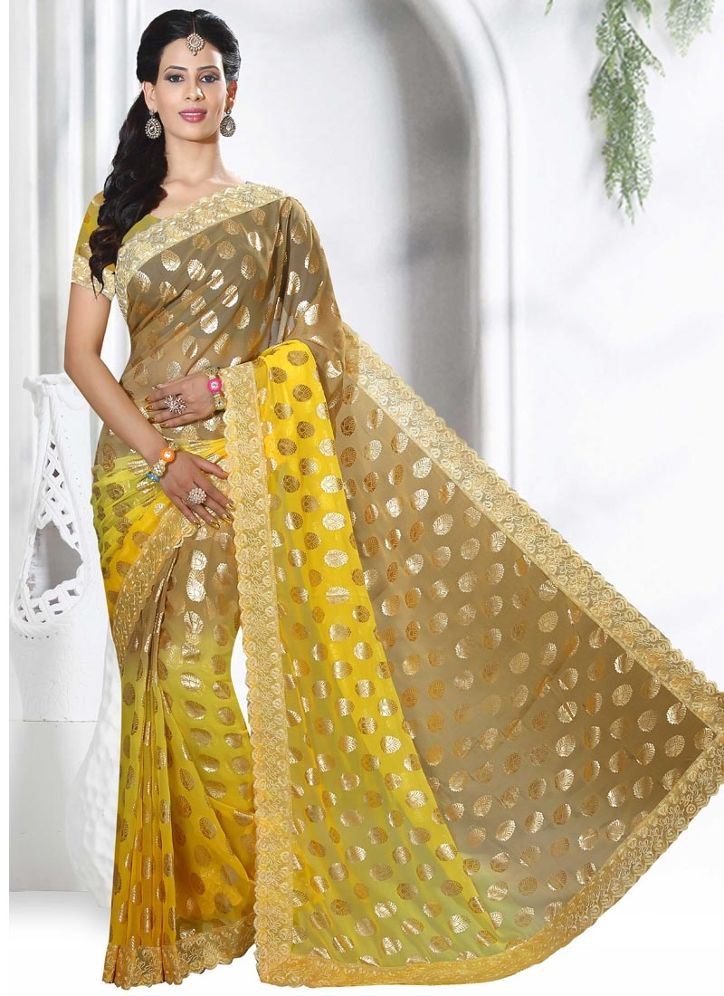 Brown And Yellow Living Room Decor: Glowing Brown And Yellow Lace Work Classic Saree