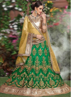 Gold and Green Net A Line Lehenga Choli