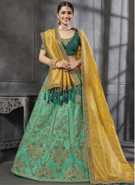 Gold and Sea Green Silk Trendy Lehenga Choli