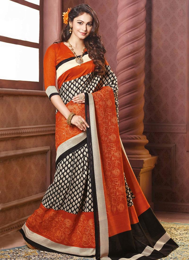 Grandiose Black And Orange Color Party Wear Saree
