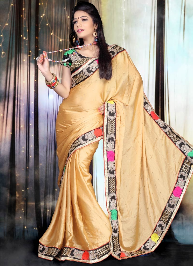 Grandiose Stone Work Beige Color Party Wear Saree