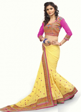 Grandiose Yellow And Stone Work Party Wear Saree