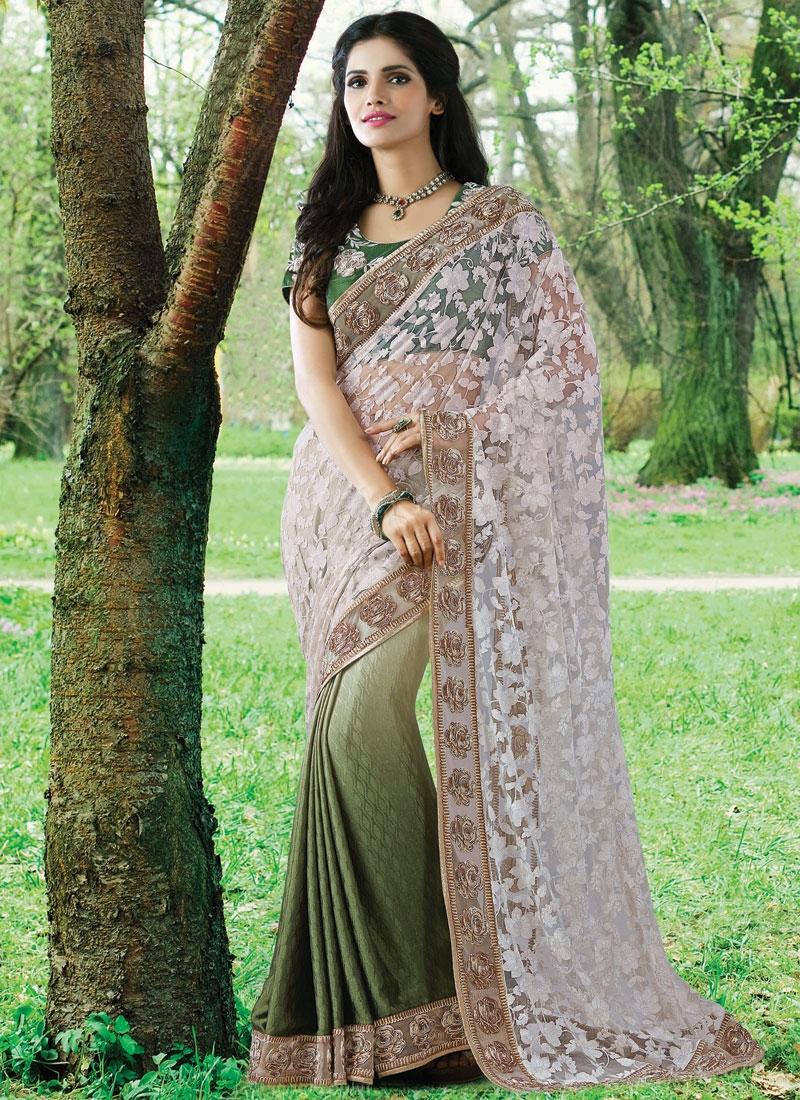 Gratifying Net Brasso Lace Work Half N Half Designer Saree