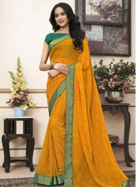 Green and Orange Faux Georgette Traditional Saree