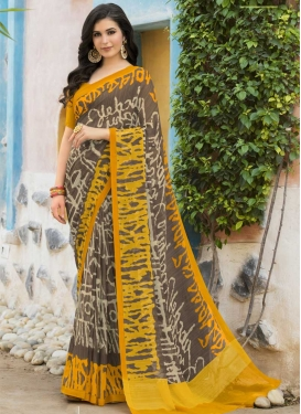 Grey and Mustard Faux Georgette Trendy Classic Saree