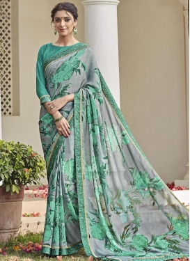 Grey and Sea Green Brasso Georgette Trendy Classic Saree
