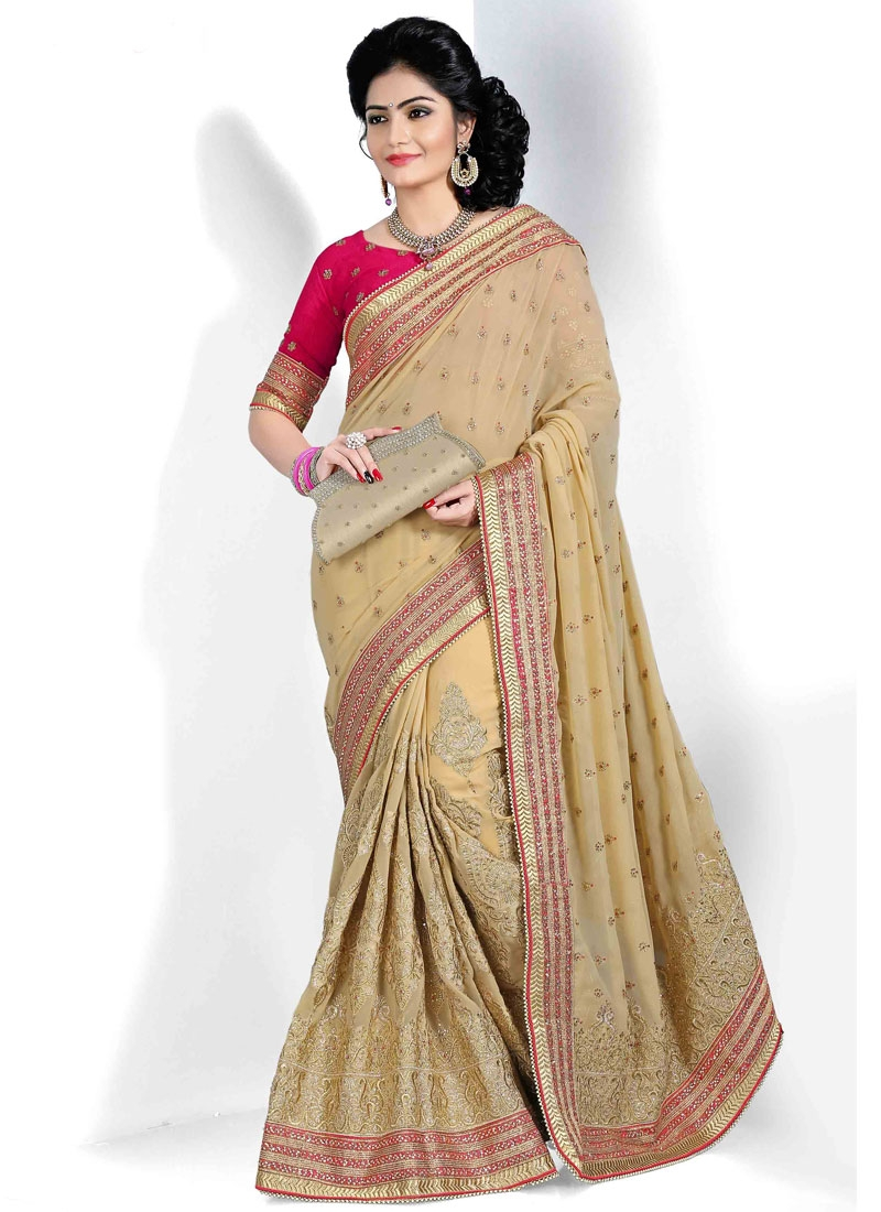 Gripping Booti And Lace Work Georgette Wedding Saree