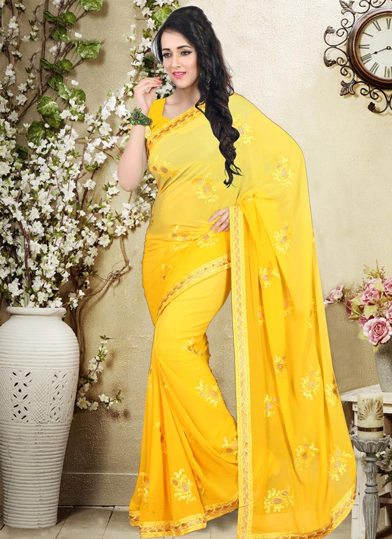 Gripping Yellow Color Faux Georgette Party Wear Saree