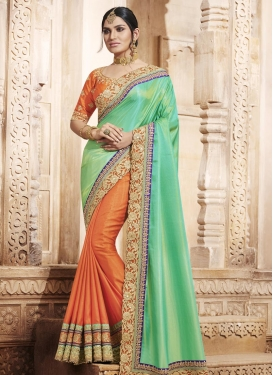 Hypnotic  Orange and Sea Green Beads Work Half N Half Trendy Saree