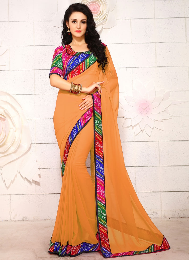 Hypnotizing Faux Georgette Mustard Color Casual Saree