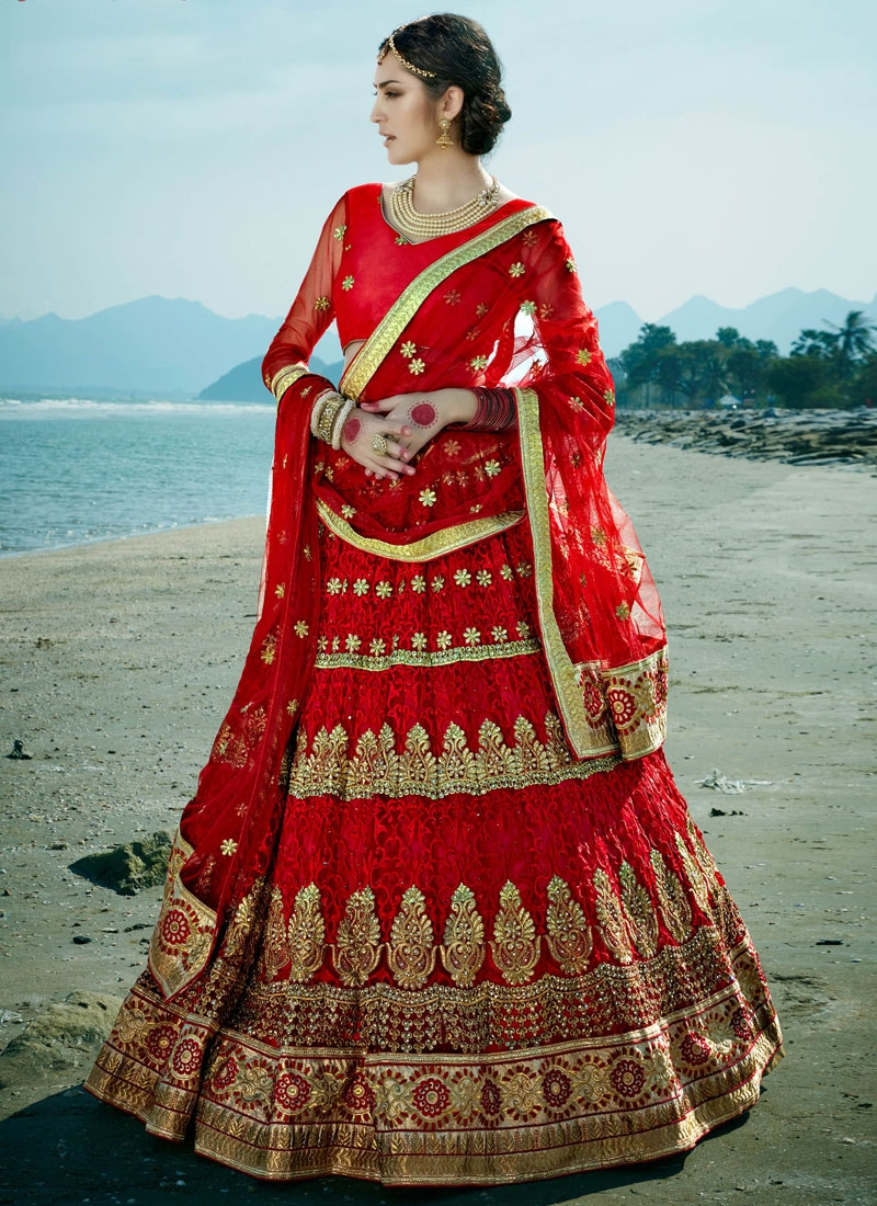 Hypnotizing Stone Work Red Color Net Bridal Lehenga Choli
