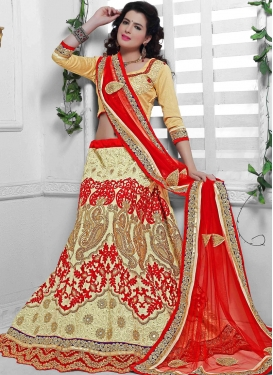 Impeccable Cream Color Net Stone Work Bridal Lehenga Choli