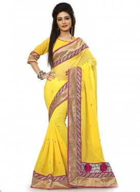 Impeccable Yellow Color Lace Work Designer Saree