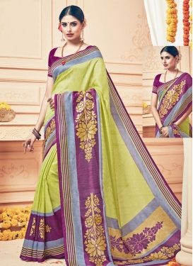 Impressive Aloe Veera Green and Purple Traditional Saree