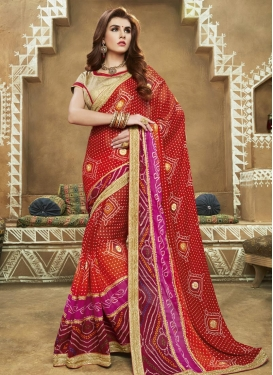Impressive  Maroon and Red Faux Georgette Trendy Classic Saree