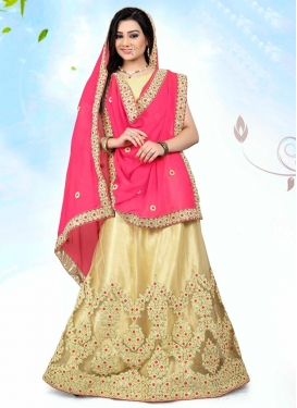 Intricate Net Cream and Rose Pink Trendy Designer Lehenga Choli For Festival