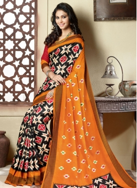 Intriguing Black And Orange Color Casual Saree