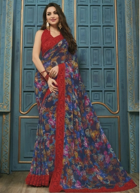 Intrinsic Faux Georgette Navy Blue and Red Embroidered Work Trendy Saree