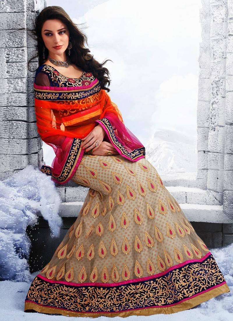 Invaluable Stone Work Net Wedding Lehenga Choli